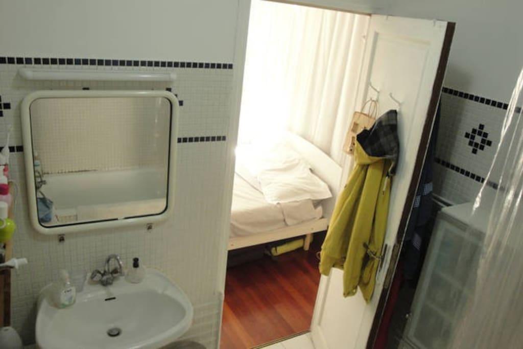 Shared Bathroom with a bath