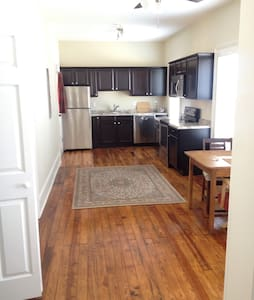 Newly renovated large 1 BR apartment 10 minute walk from City Market. Hardwood floors, AC, gas heat, private porch, washer/dryer in unit.   the basics, including dishes, pots and pans, towels and sheets, kitchen table, chairs and futon for the bed. Not much other furniture. Apartment is also for rent for $895/month for a year lease.