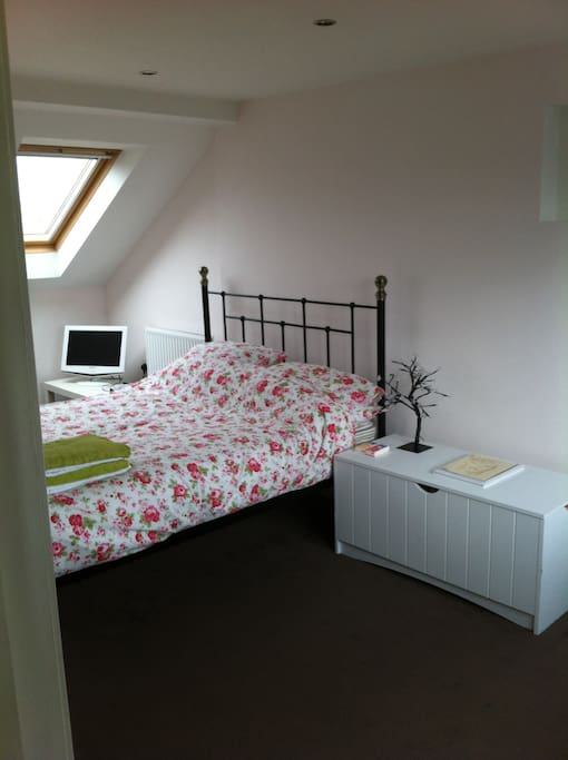 double bed in large private room with en suite, on separate floor of house