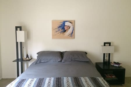 Beautiful one bedroom apartment. Simply furnished with cozy furniture and custom art. Safe and lovely neighborhood only 4 miles from the beach. Great pool and lounging in the courtyard.  Private patio through the bedroom.
