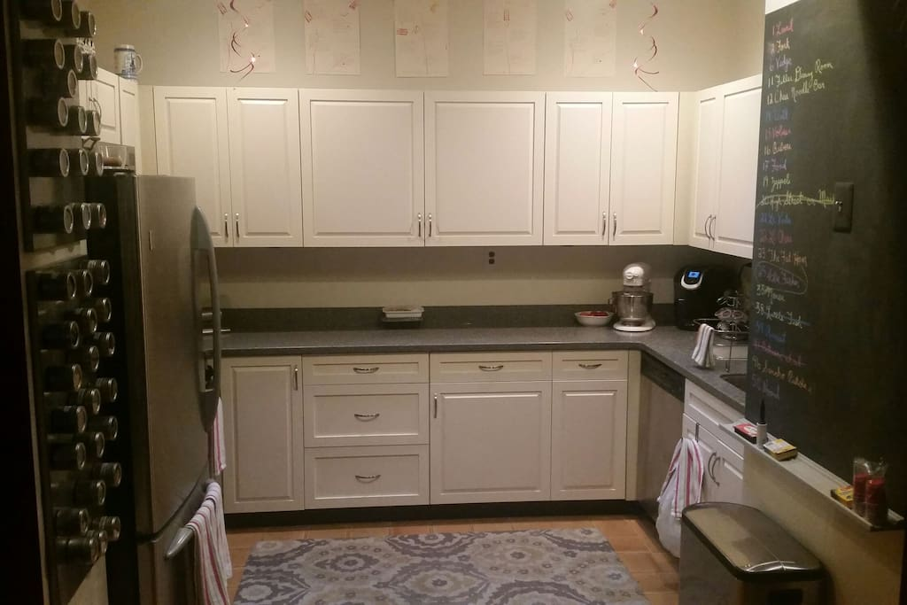 Kitchen with full-sized refrigerator and gas stove/oven