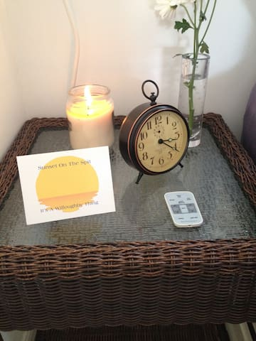 The nightstand with a fully functional alarm clock.