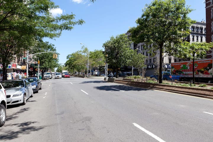 We are right on Broadway-- a well-traveled thoroughfare with tons of great restaurants and easy access to trains!