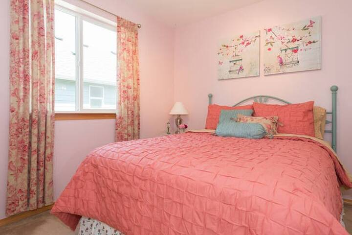 Queen size bed in the cozy room