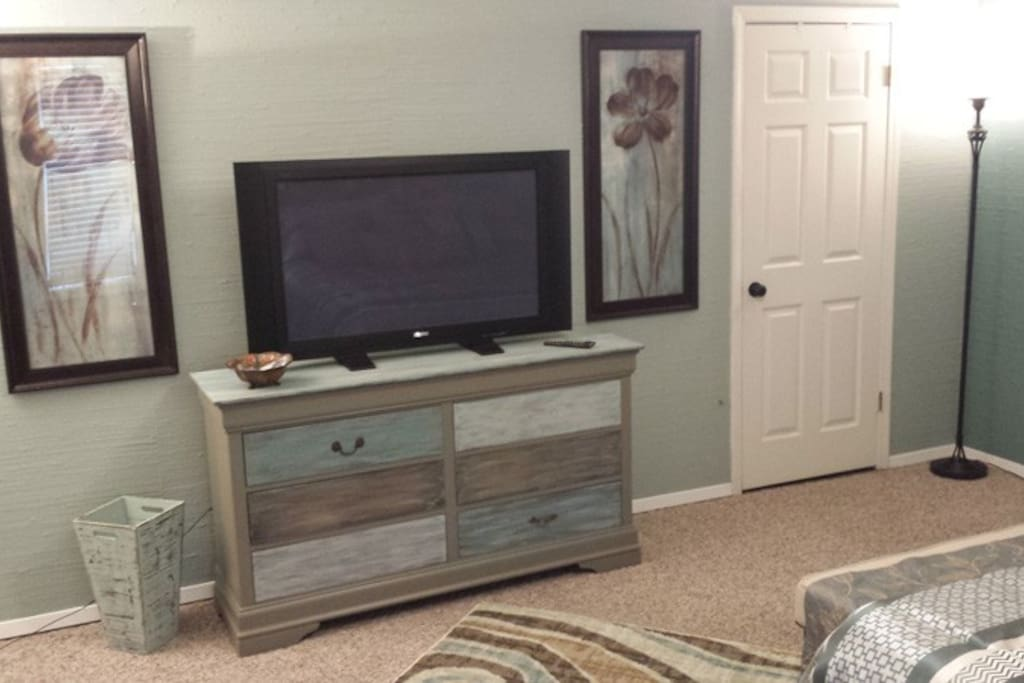 Closet and chest provide plenty of storage.  42 inch TV with cable.  Iron and ironing-board in closet.