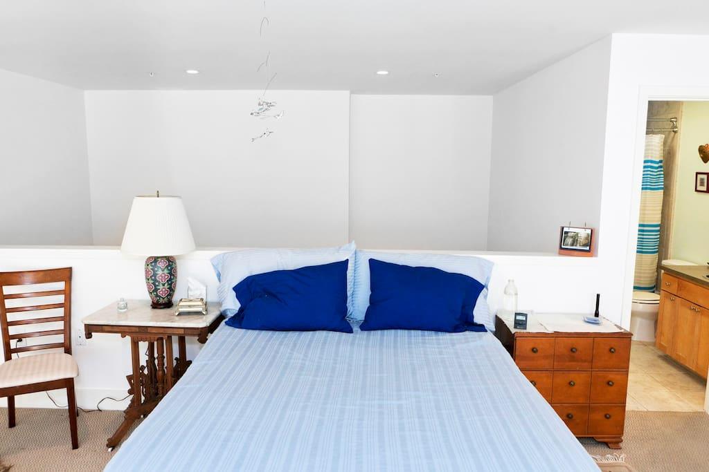 Queen size bed in loft.