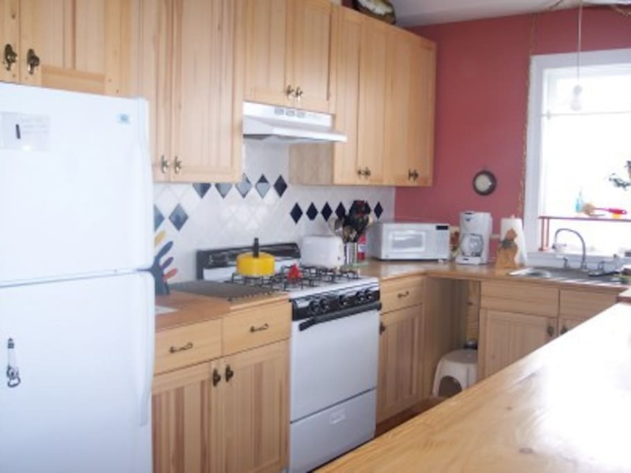 Full kitchen with gas range.