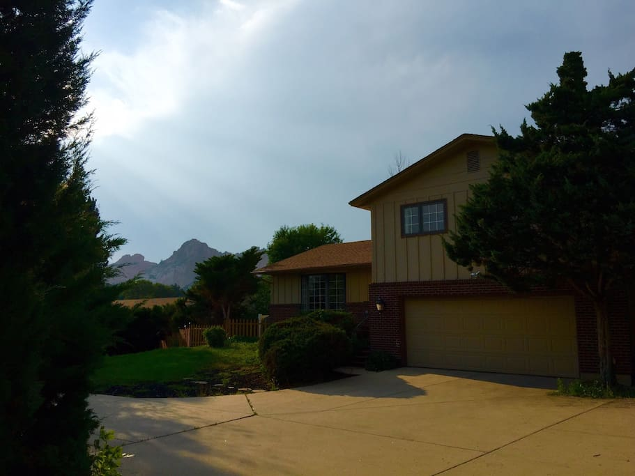 View of front of home with Garden of The Gods in background