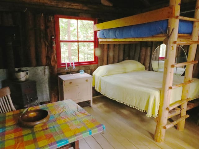 Inside the smaller cabin, double bunk beds. Bring sheets or sleeping bags.