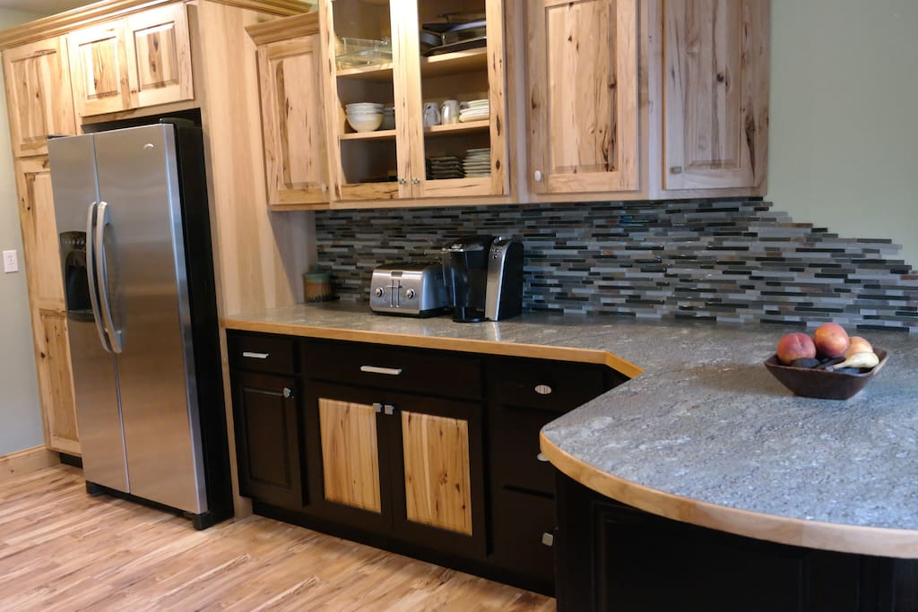 Designer Kitchen with new stainless appliances and high quality filtered water in the fridge.