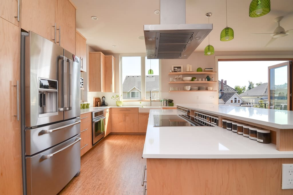 You'll love cooking on the quartz countertops, you'll love all the supplies, you'll love all the light.