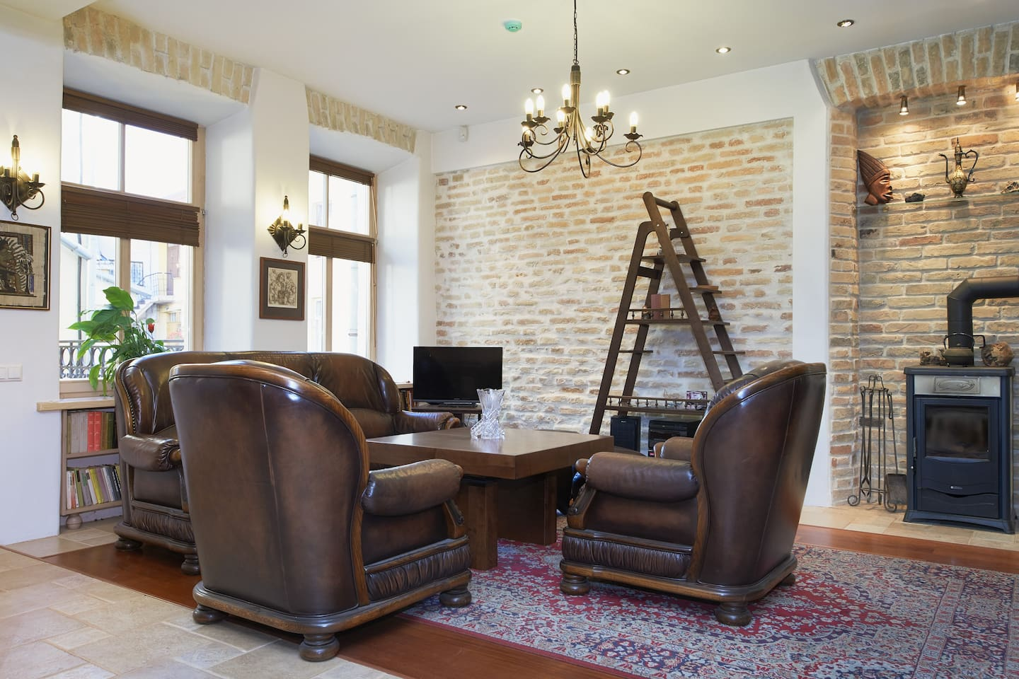 Living room with a table transformer, that from coffee table become a 4 or 8 places dining table; Internet and Satellite TV