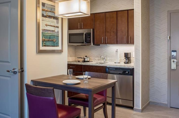 Fully equipped kitchen with a microwave, coffee maker, toaster, refrigerator, stove, dishwasher....
