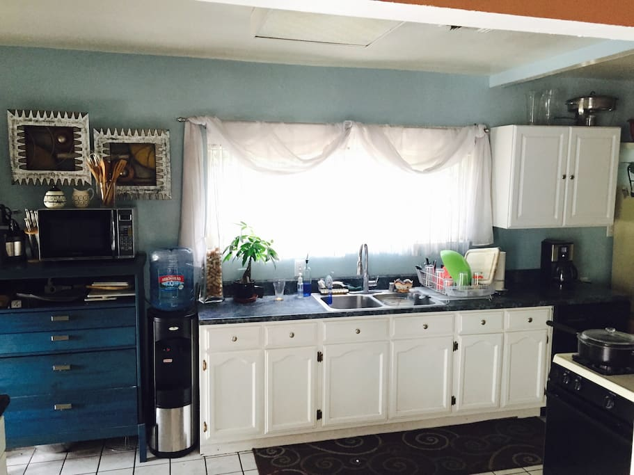 Roomy kitchen with lots of space and light. Water delivery service included.