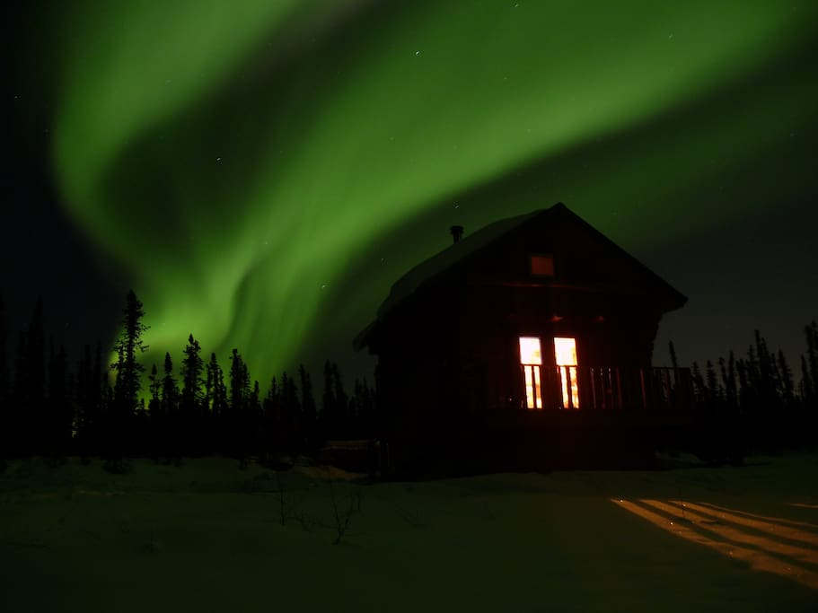 Northern lights dancing above Nautique Sky cabin