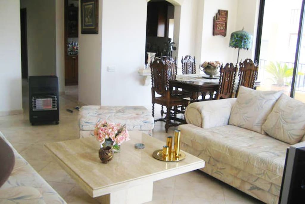 Comfortable and bright lounge overlooking Swieqi valley with a large terrace.