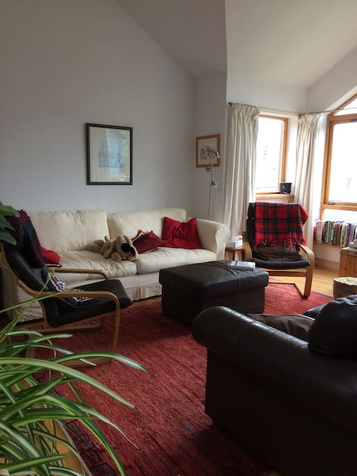 Living space has a large four seater couch and a smaller two seater, TV/DVD player folds away against the wall. Living space is upstairs so views of the Findhorn bay are on offer.