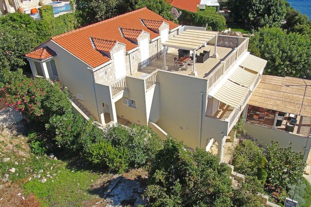 View of the villa from above. The long, covered balcony is part of the second floor apartment.