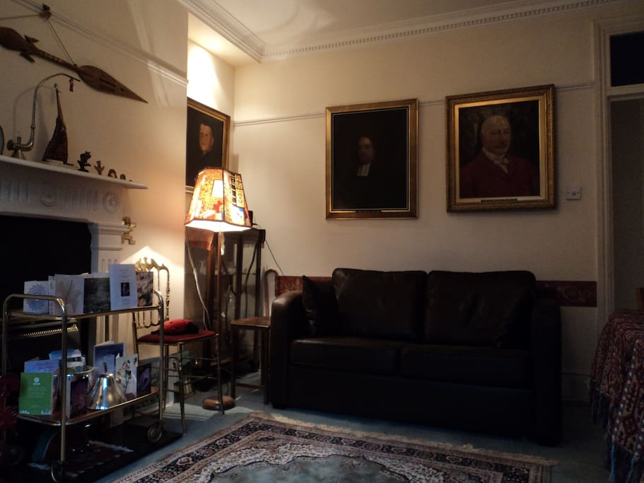 Characterful main room with historical family portraits
