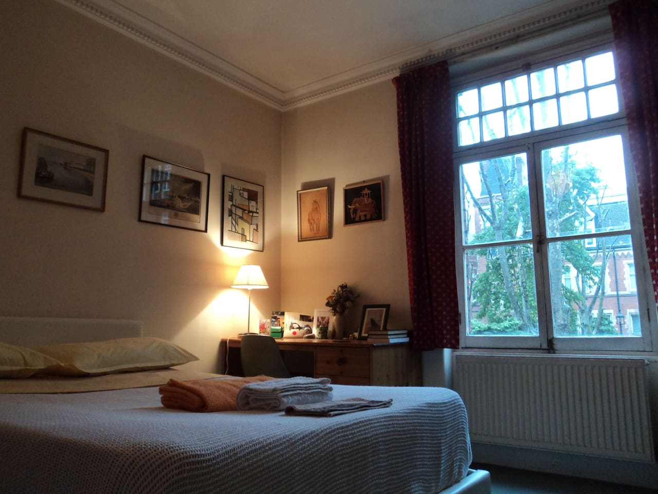 Bedroom with desk and pleasant view over a small  garden square