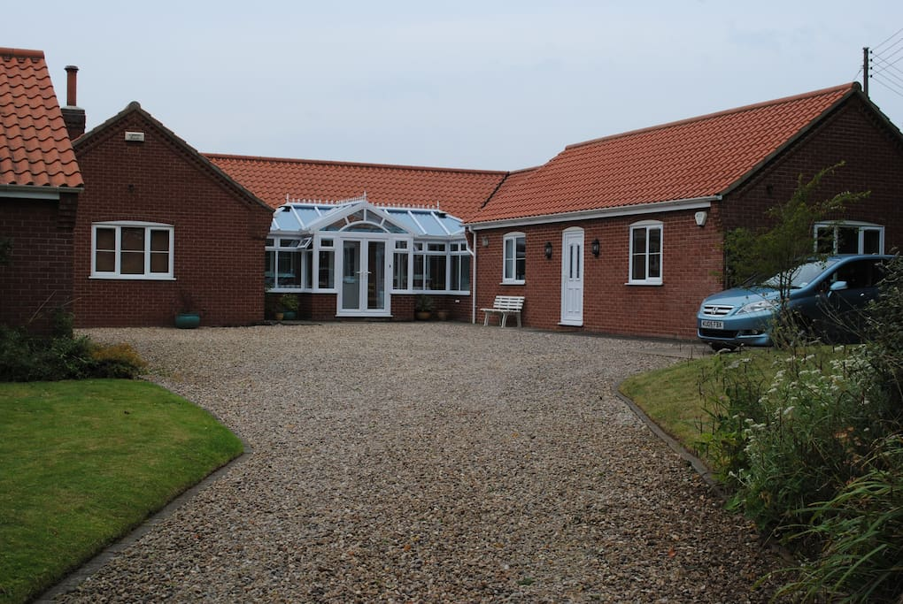 The B&B accommodation is adjacent to the breakfast conservatory and your hosts' bungalow.