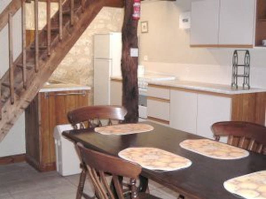 large kitchen and open space dining area with table, 6 chairs, buffet, fan/light, fully equipped kitchen