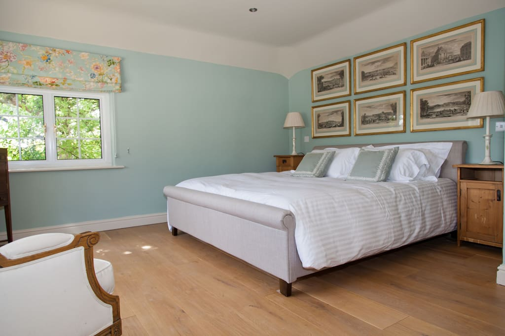 Comfortable super kingsize bed with village view