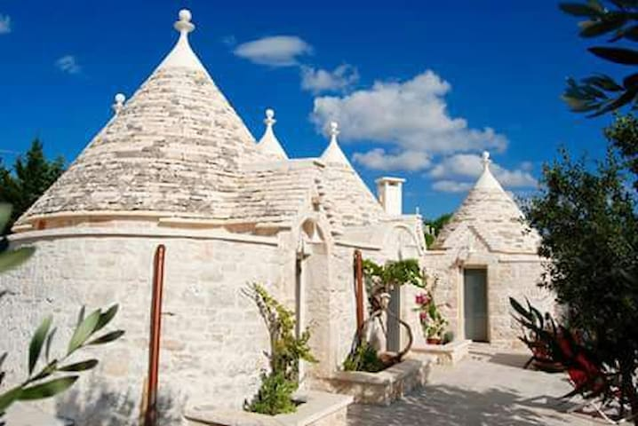 typical trulli in the quiet country - cisternino
