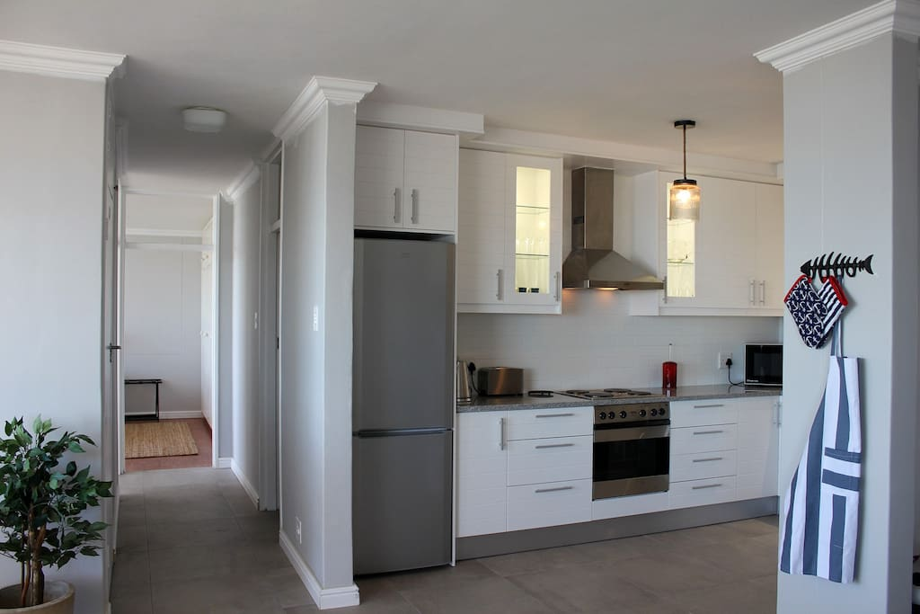 Open plan kitchen with Dishwasher, Microwave, Oven, Hob, Fridge etc.