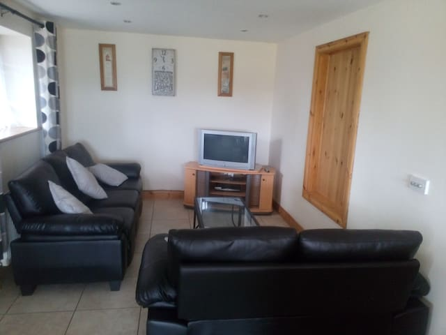 Kitchen/Diningroom inc TV and kitchen with oven & hob overlooking Lough Mask.