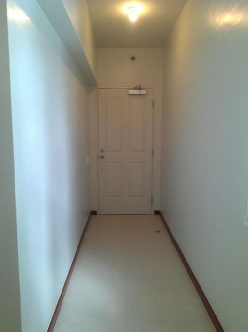 Main door and hallway inside the unit.