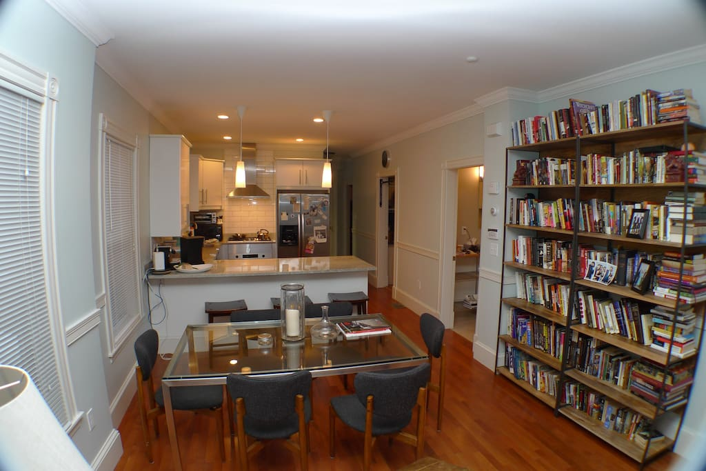 Bookshelves, glass-top dining table