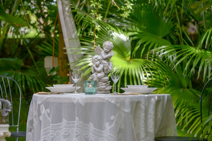 Enjoy a intimate garden dinner party for your self.