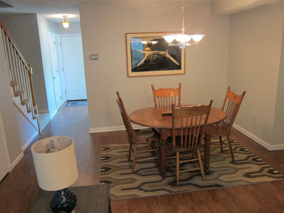The dining area allows guests to enjoy a meal at home and is open to the living room.