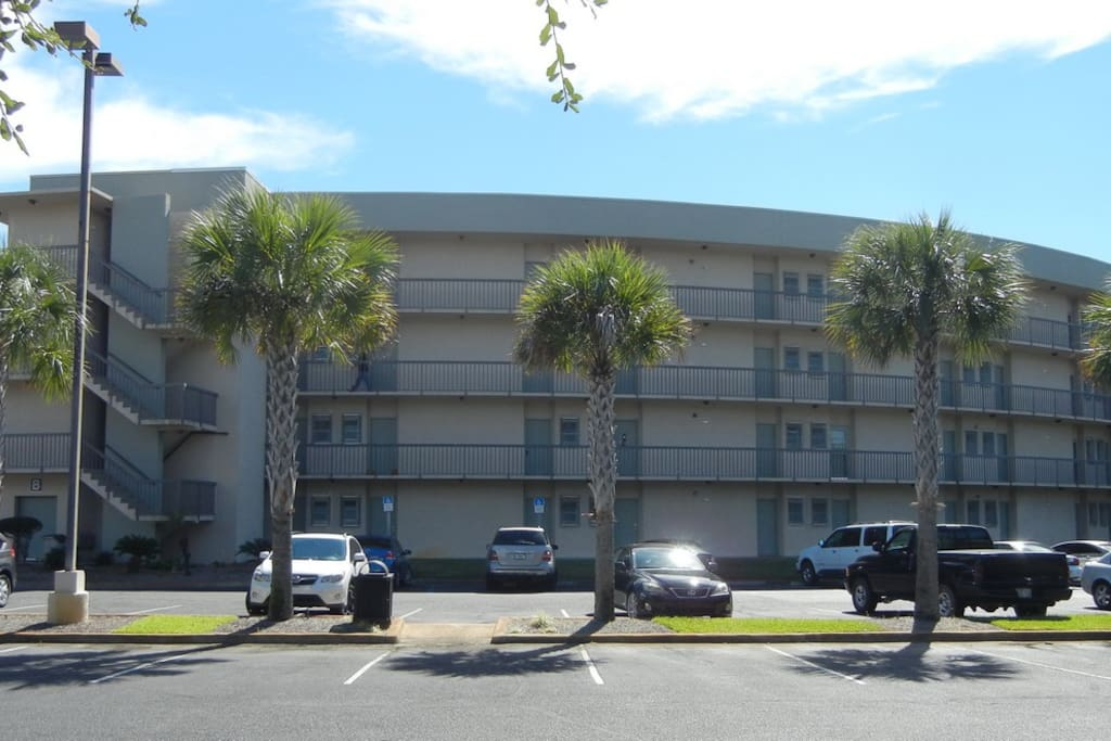 Front of B building featuring ample parking space.