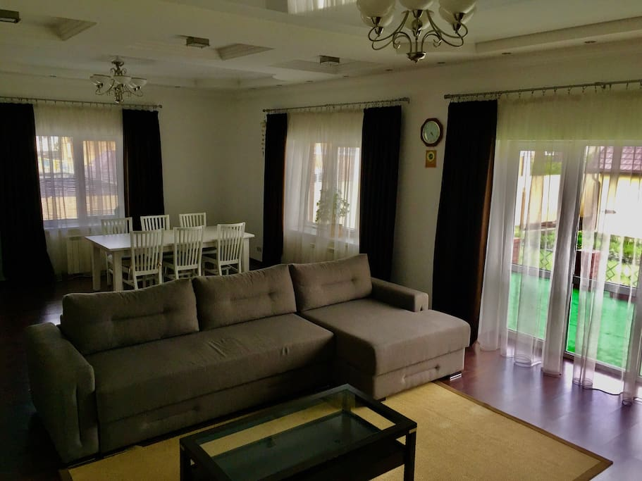 Living room on the first floor with wardrobe and big sofa, can accommodate 2-3 people.