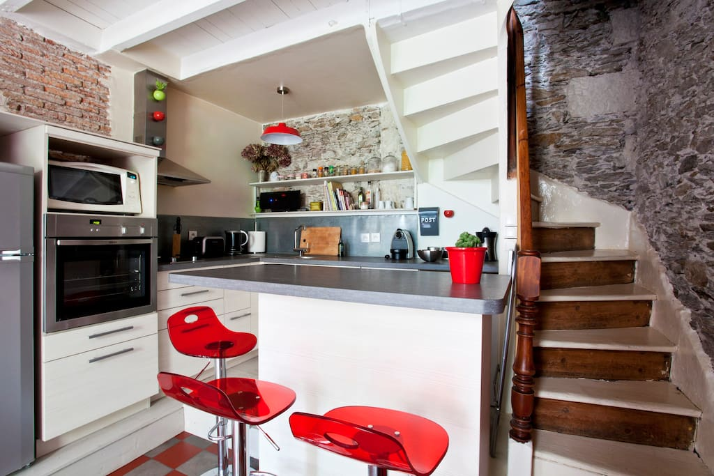 Fully equipped kitchen. Bedrooms accessible by the stairs on the right.
