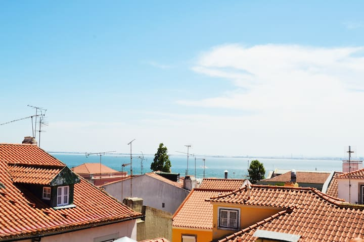 From Nidus, you can see Tejo river and Lisbon rooftops