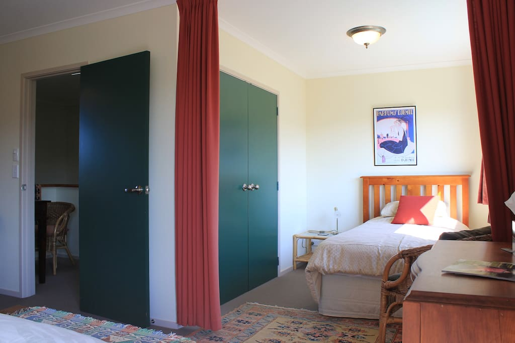 King-single bed in curtained-off alcove