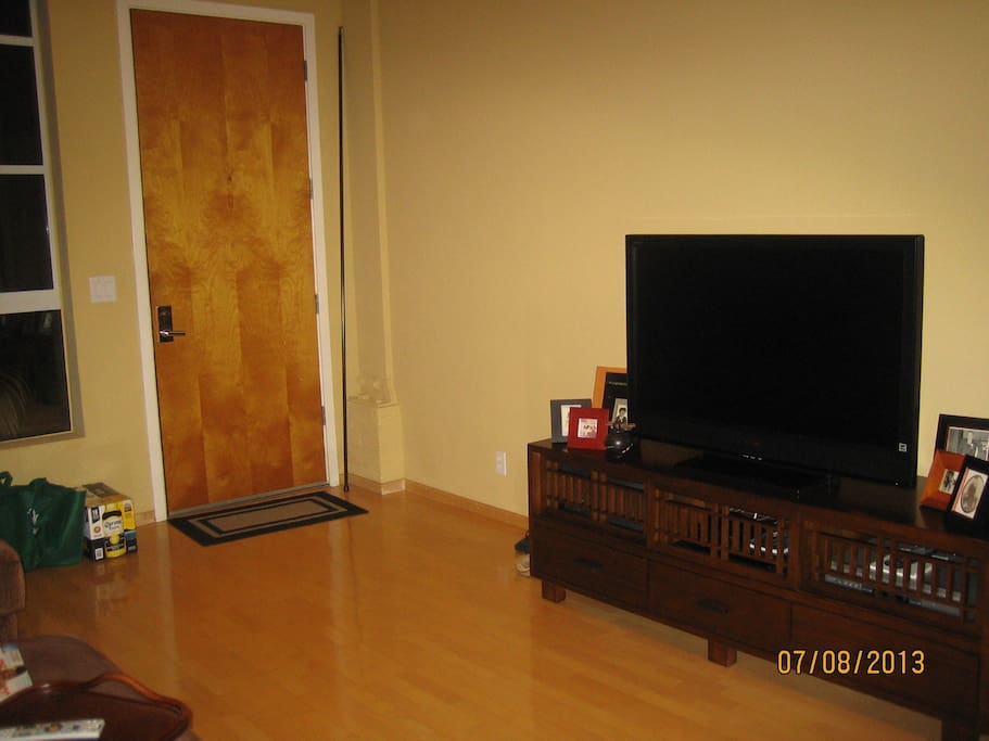 TV with Direct TV service, Apple TV and DVD player.