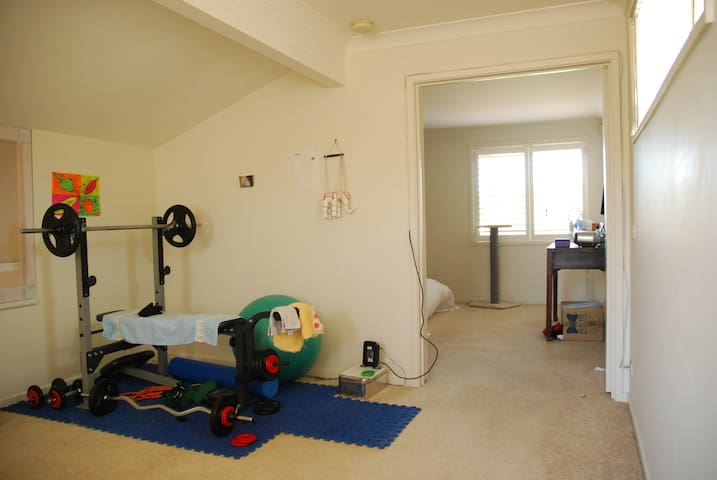 The mezzanine that leads to the master bedroom has some fitness equipment...
