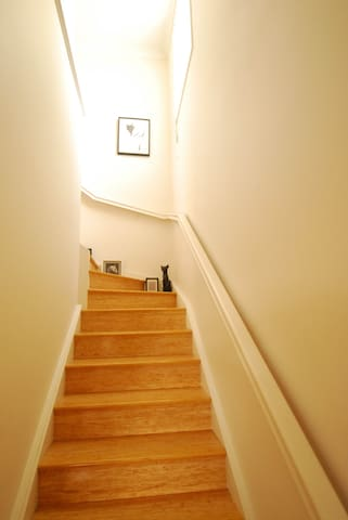 Stairs leading to mezzanine and master bedroom