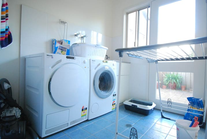 The laundry has a washer and dryer