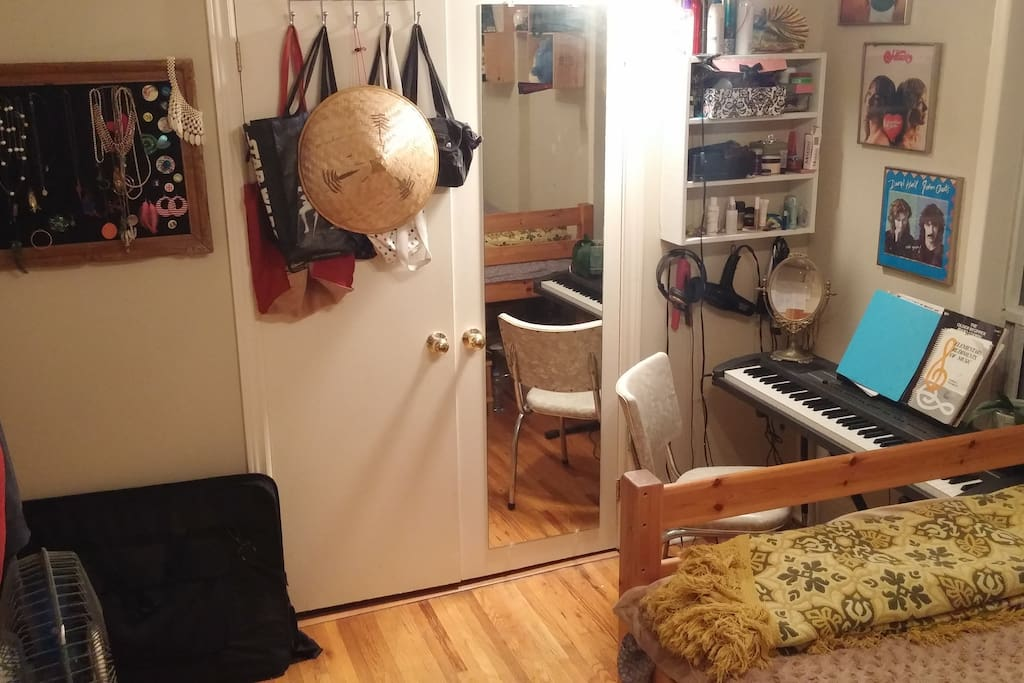 large closet with long view mirror. You're free to play piano if you like!