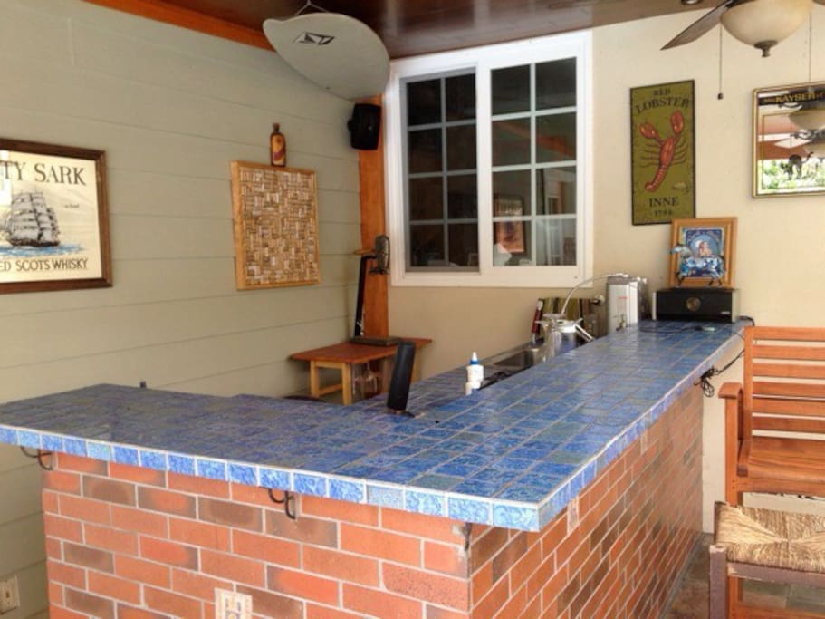 outdoor bar with fridge and sink for those of you that would rather BBQ and enjoy the backyard