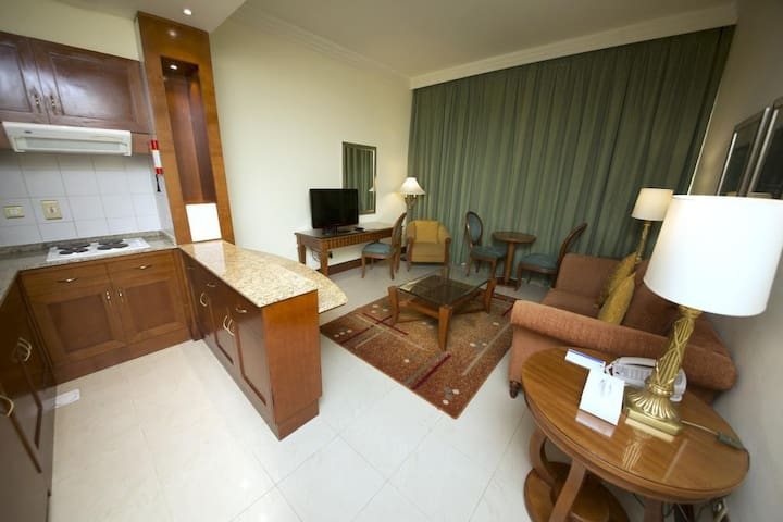 ONE BEDROOM-HALL AND KITCHEN  PEARL CITY SUITES