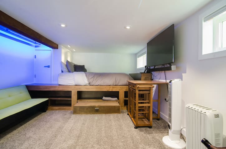 The bed is super cozy, elevated in a nook with shelving below and a great view of the TV, which rotates off of the wall.
