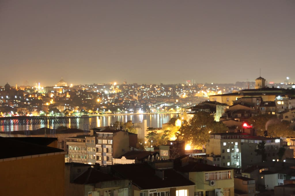 Here is the view of Golden Horn! Sitting on my balcony with some booze at night.