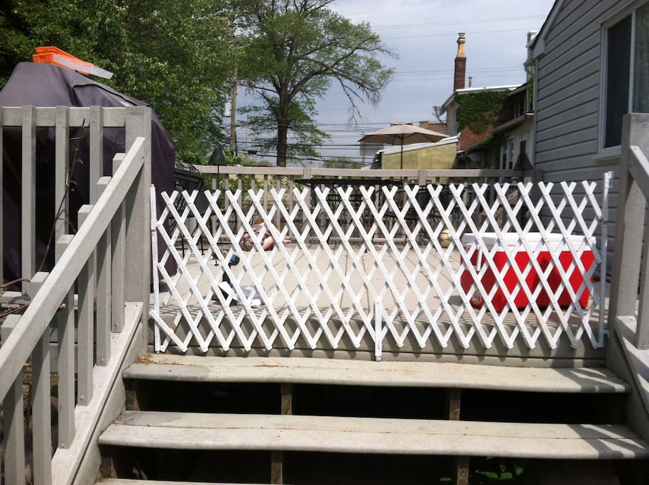 large fenced in deck with propane grill- clean and ready