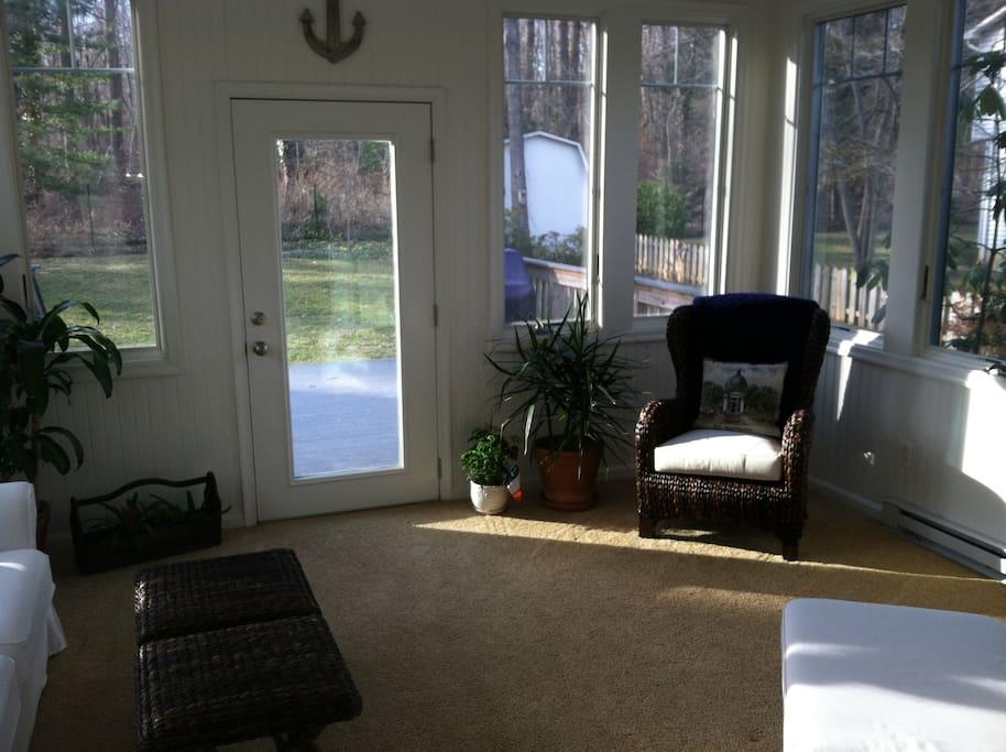 Four-season sun room for relaxing.